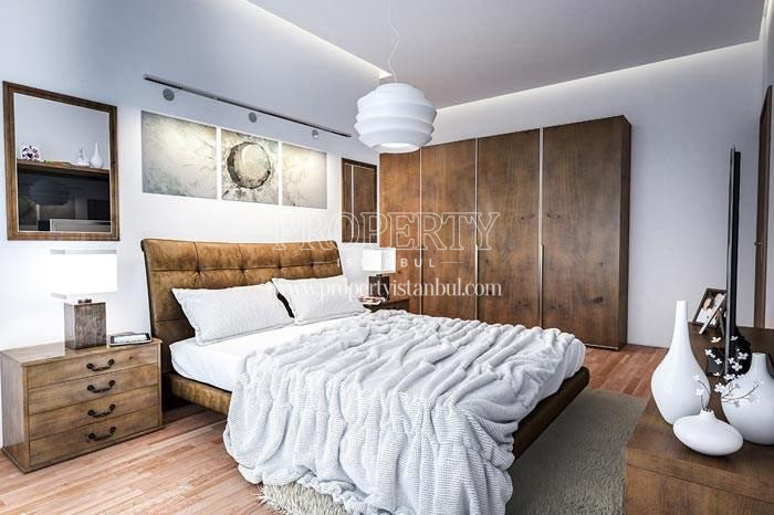 Wooden furnitured master bedroom in Elysium Apartments Lale