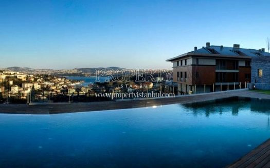 Large outdoor swimming pool facing to the sea view in L'ist Istinye Suites