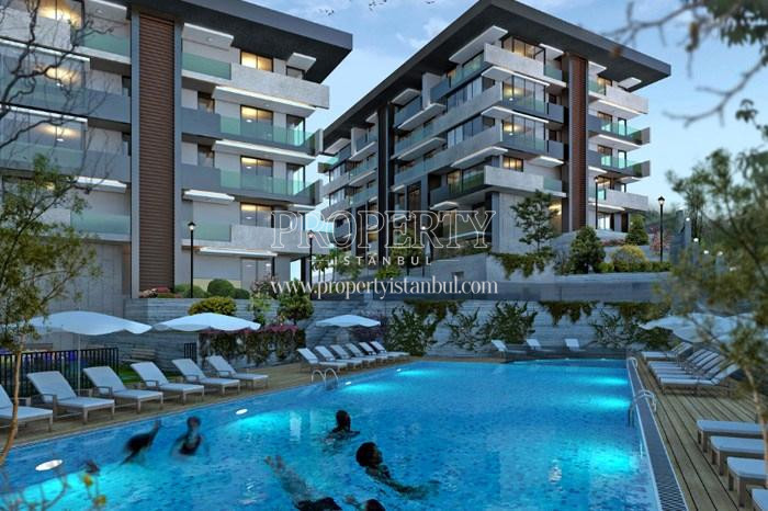 People swimming in the compound swimming pool in Tarabya Life