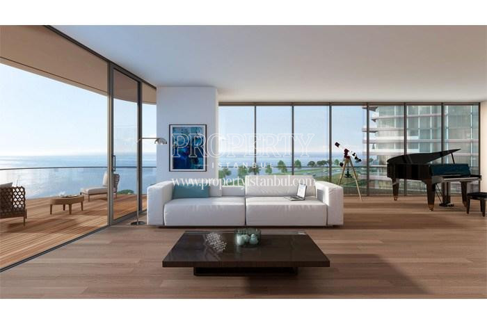 White sofa and piano in one of the having the sea view living rooms in Yedi Mavi