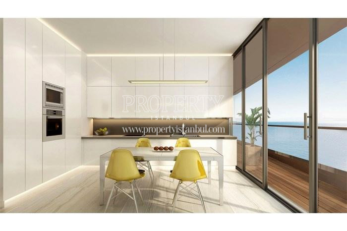 White spacious kitchen with the balcony and the sea view in Yedi Mavi